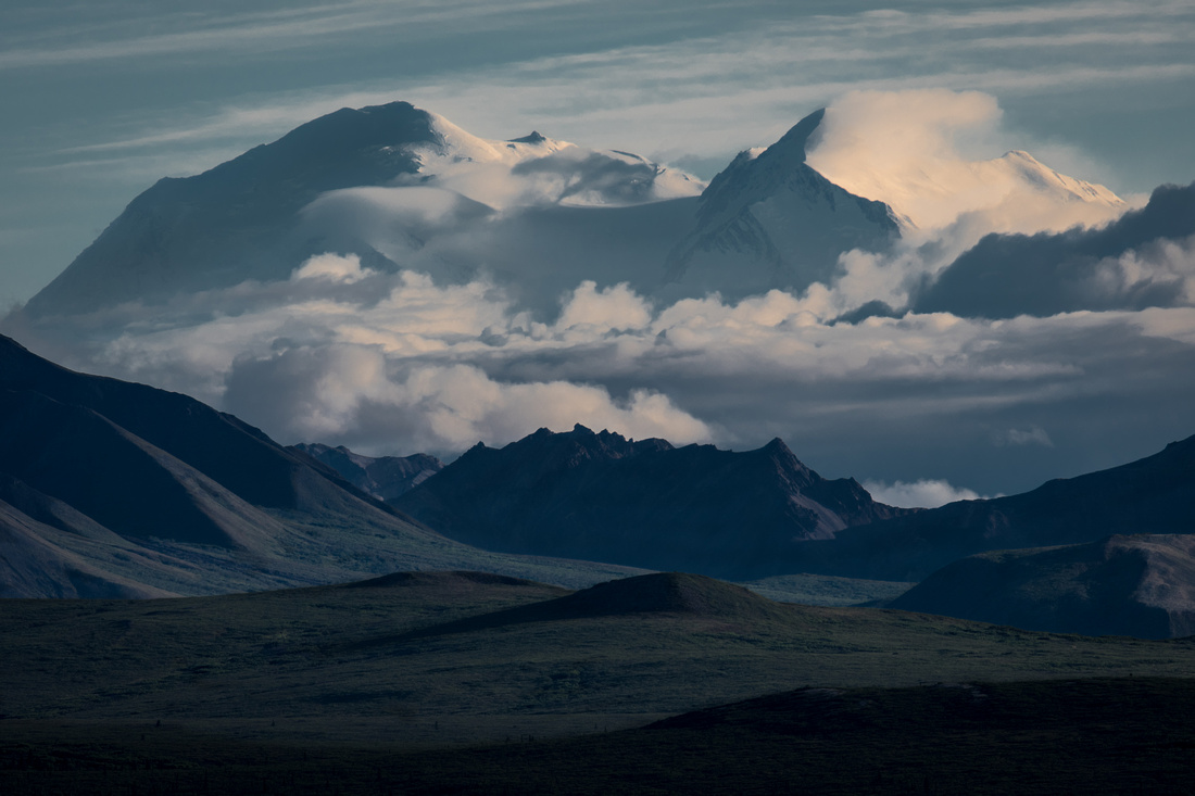 Mt Denali rises above the clouds and surrounding mountains from mile 12 in Denali Natl Park, Alaska copy