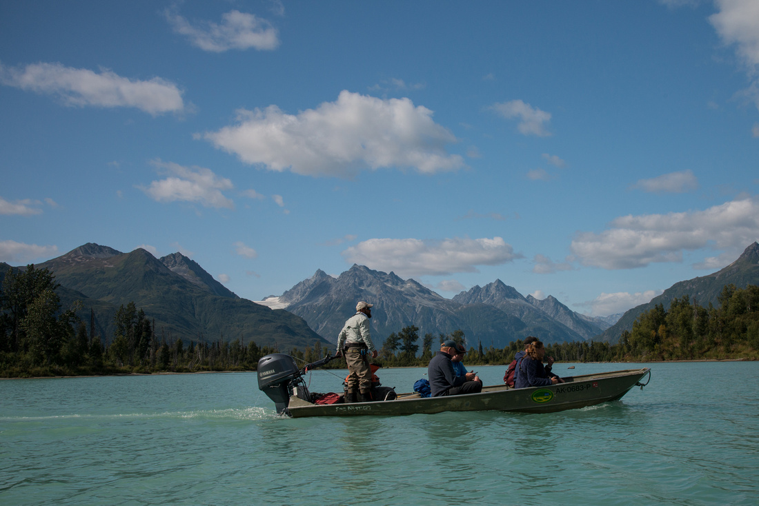 A bear viewing tour boat with tourists on Crescent Lake in Lake Clark NP, Alaska, USA
