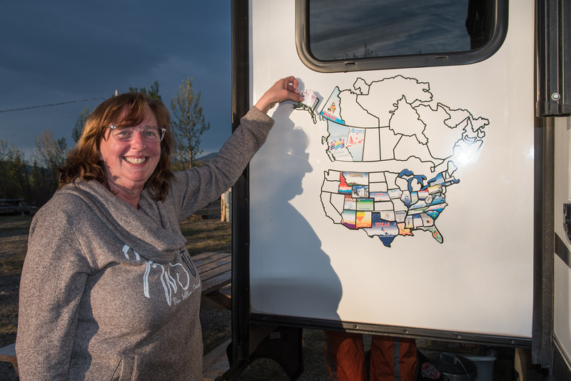 Marie puts our Alaska State Sticker on our map