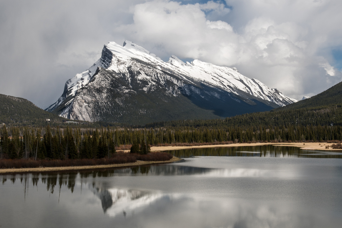 A view of Mount Rundle reflecting in Vermillion Lakes in the foreground, Banff National Park, Alberta, Canada