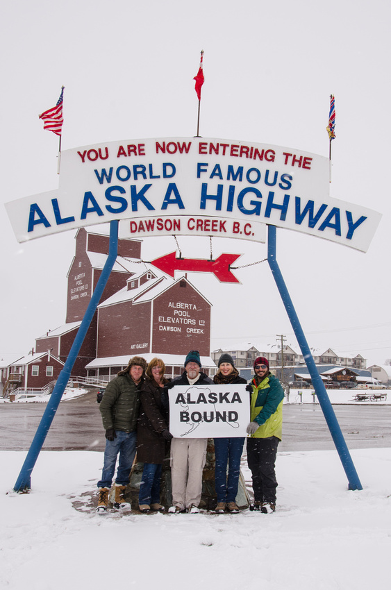A group of Alaska bound travelers pose at the start of the Alaska Highway in Dawson Creek, British Columbia, Canada